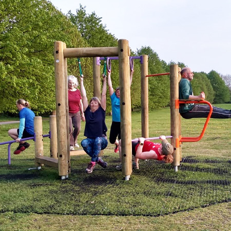 Group using outdoor gym equipment run by Move the Masses charity