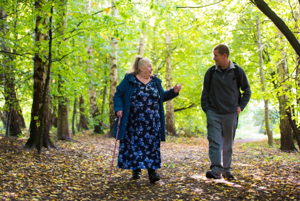 Move Mates walking through the woods