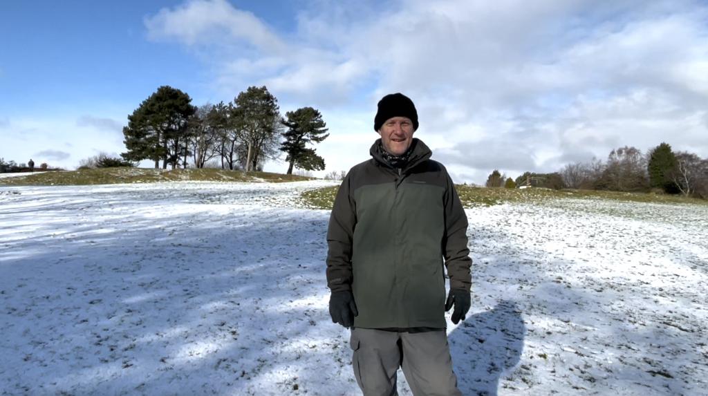 Chris stood on a snowy Bachelor Hill
