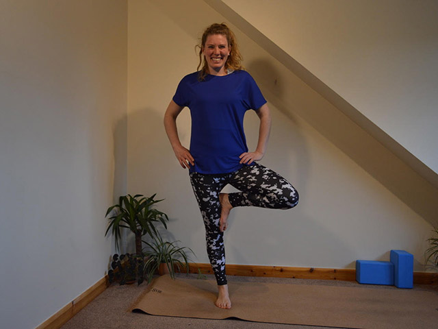 A photoo of Laura in tree pose