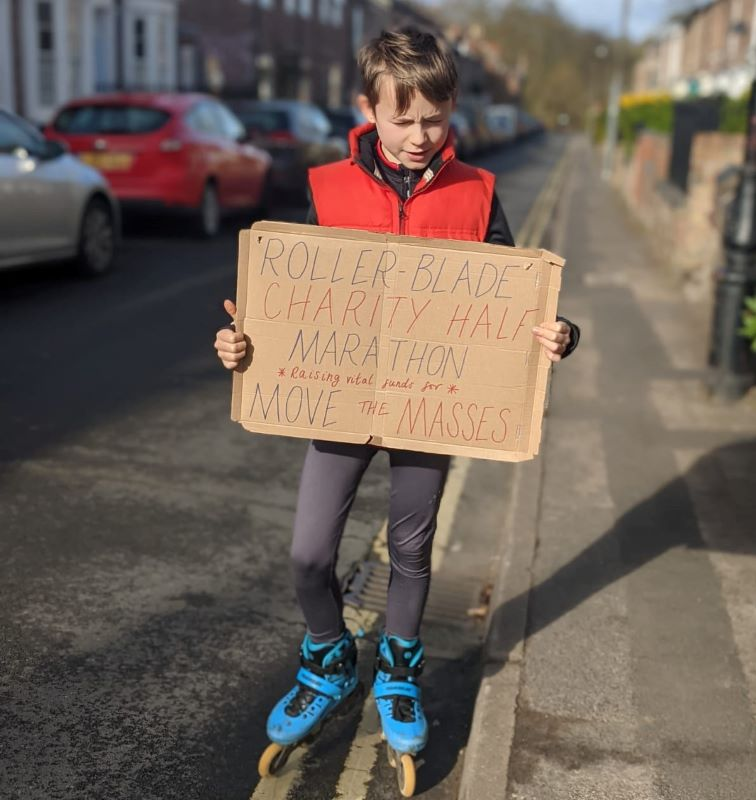 Noah on his skates with a fundraising sign