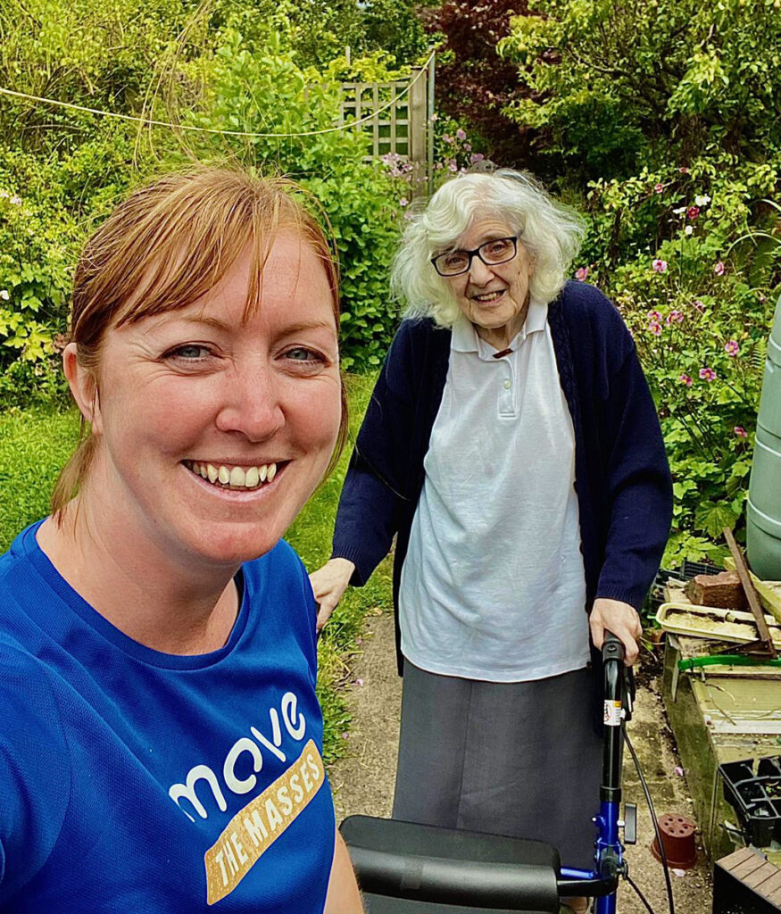 Move Mates volunteer with elderly lady going for a walk