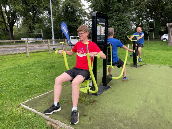 Image of happy person using outdoor gym