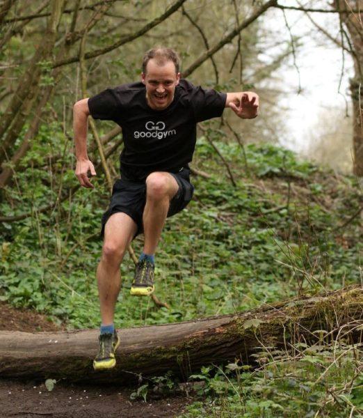 Matt jumping over a log